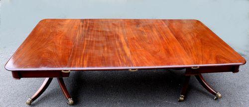 Regency twin pillar mahogany dining table