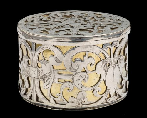 A circular strapwork Box, silver and parcel gilt, Dutch c.1660