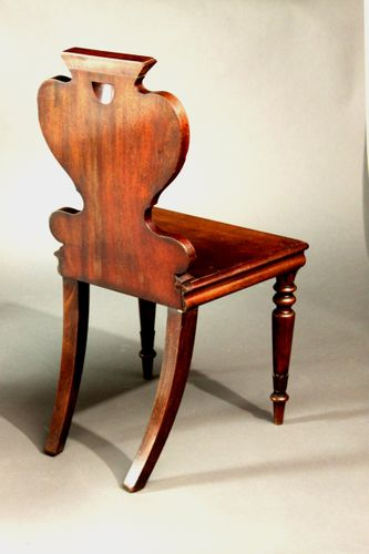 Four armorial hall chairs