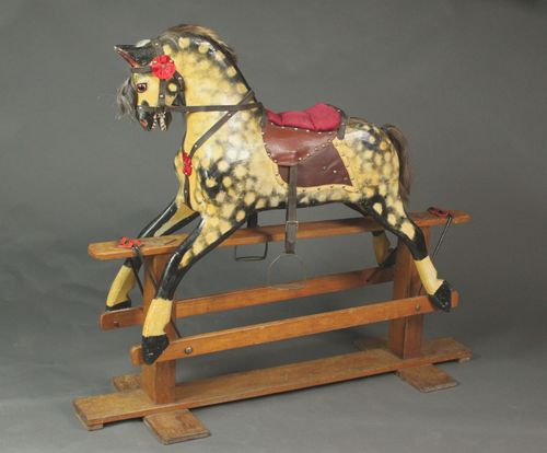 Large rocking horse by Collinson