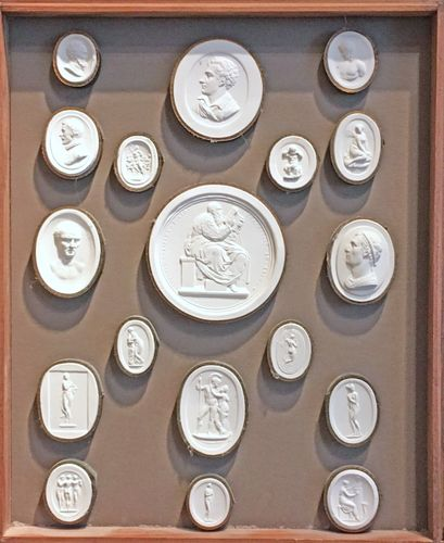 A framed & boxed collection of 61 intaglios / plaster medallions