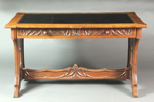 Neo-Gothic carved oak writing table