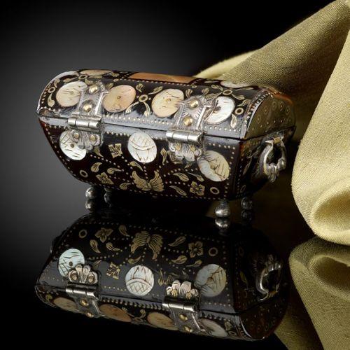 A miniature tortoiseshell casket in the shape of a cassone