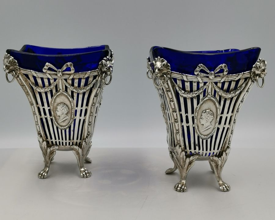 Pair of Adam style Edwardian silver flower vases