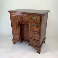 Small George II walnut kneehole desk