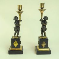 Pair of Bronze & Ormolu Putti Candlesticks