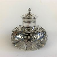 Inkwell with silver top and silver overlay