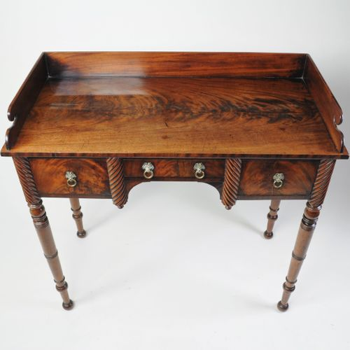 Regency figured mahogany side table with gallery