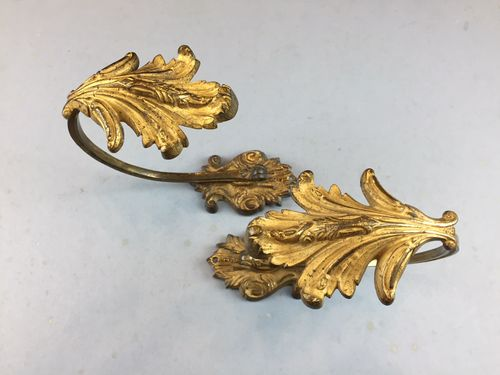 Pair of gilded brass curtain tie-backs