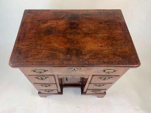 Small George II walnut kneehole desk