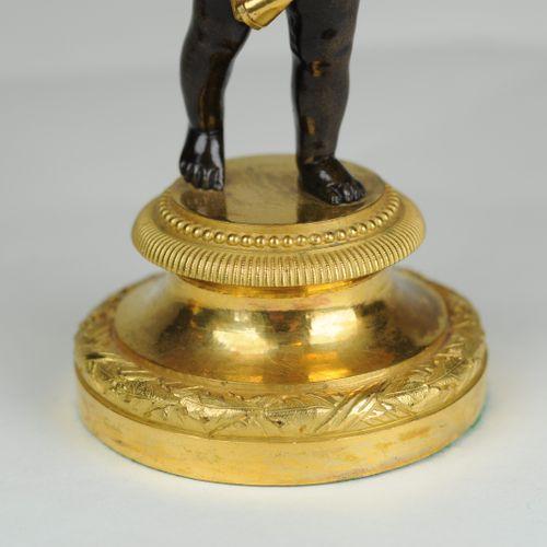 Fine pair of bronze & ormolu putti candlesticks