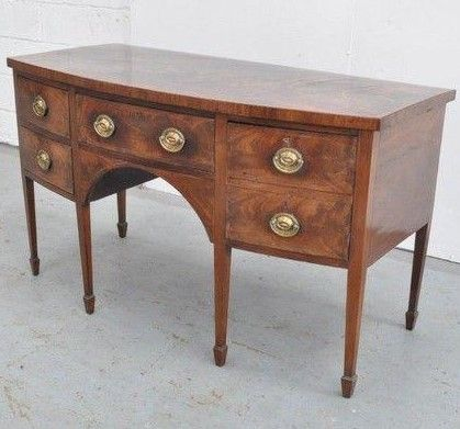 A George III mahogany bow fronted sideboard