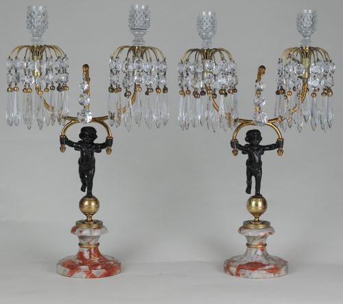 Bronze & ormolu lustre-drop candelabra supported by putti