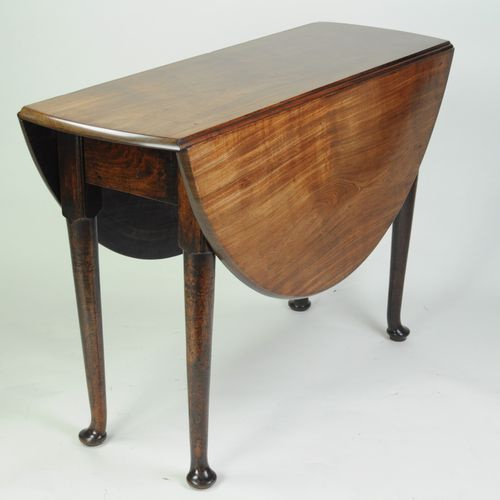 Fine quality figured mahogany oval drop leaf dining table