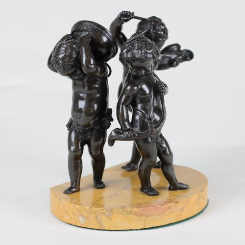 Bronze group of musical putti