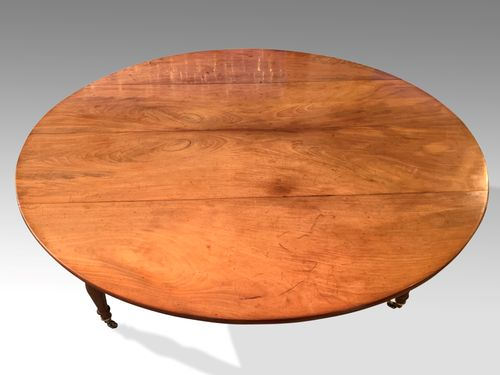 Large Pale fruitwood circular Dining Table