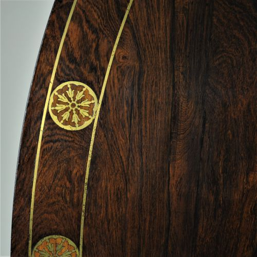 Rosewood and brass inlaid oval breakfast table