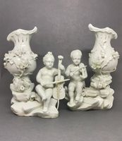 Pair of Tournai Figures of Children Playing Musical Instruments