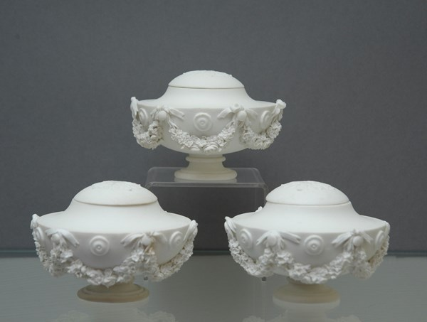 A Set of Three Sèvres Biscuit Vases and Covers