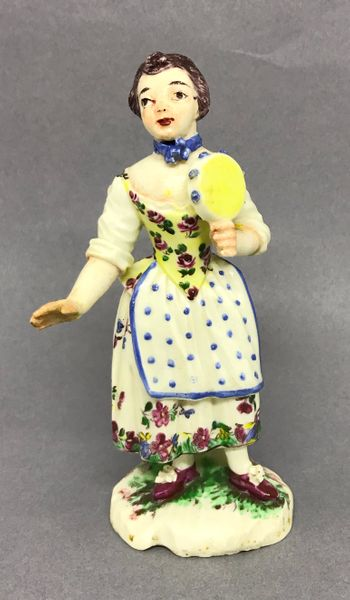 Mennecy figure of a Lady Tamourine Player